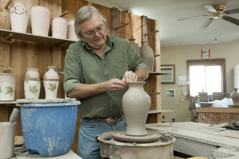 Man Making Clay Pottery