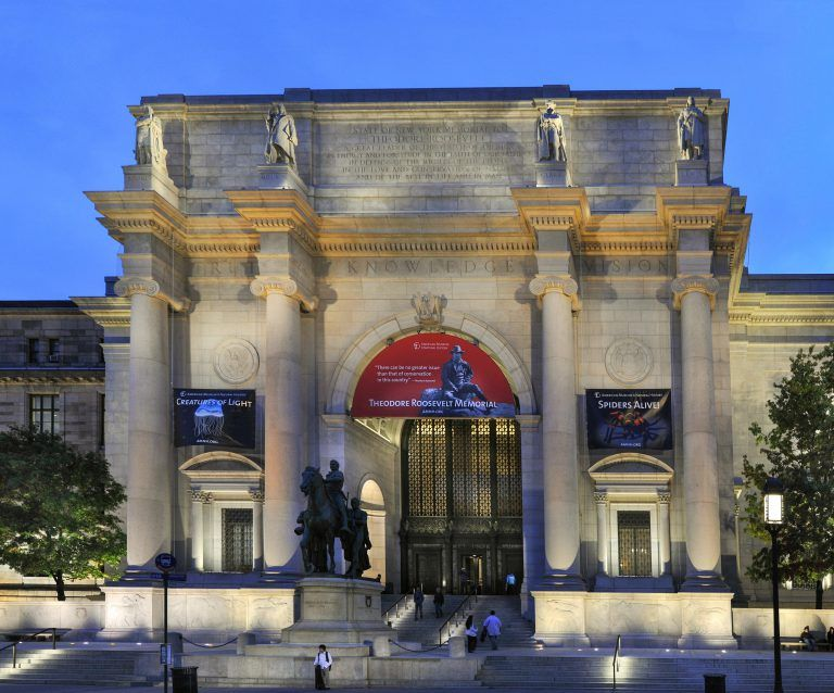 evening view of the main entrance to the American Museum of Natural History with uplighting in NYC, New York, USA