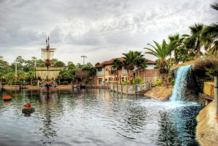 view of waterfall and lake with ship at the Mutiny Bay Golf mini golf in Myrtle Beach, South Carolina, USA
