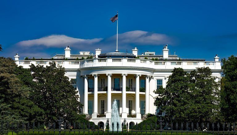exterior view of The White House 1600 Pennsylvania Avenue on a sunny day in Washington, D.C., USA