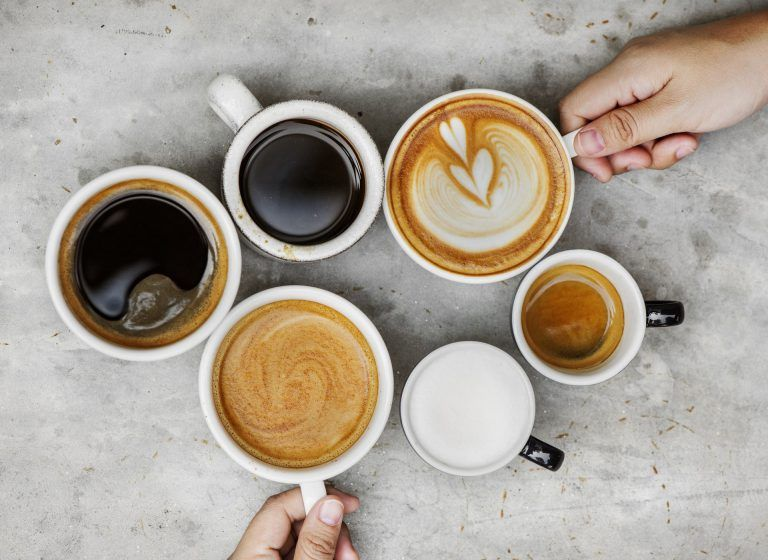 different cups of coffee and lattes