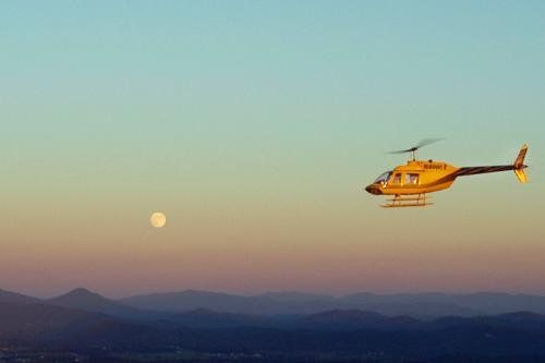 Scenic Helicopter Tours with Moon in Background