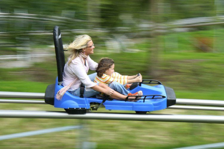 mother and daughter riding down The Runaway Mountain Coaster in branson missouri