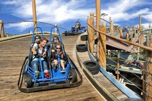 families riding go carts at the track in branson missouri