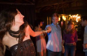A couple takes a salsa dancing class as one of the sweet things to do in San Diego for couples