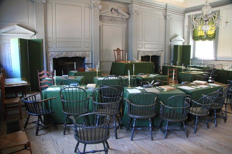 interior view of desks and chairs with candles inside the Independence Hall in Philadelphia, Pennsylvania, USA