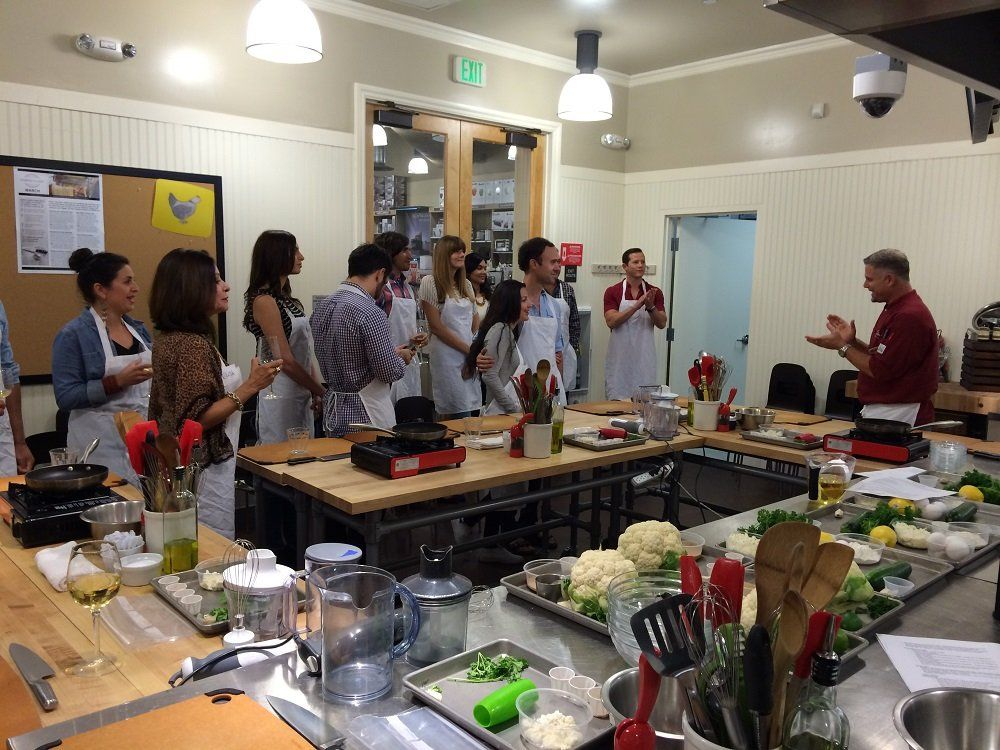 cooking students listen to instructor during class at Sur La Table