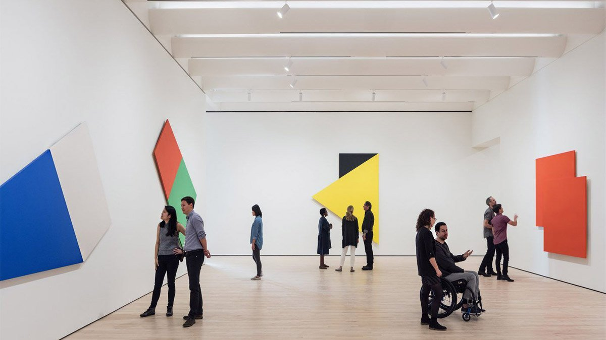 people standing around the gallery at the san francisco museum of modern art