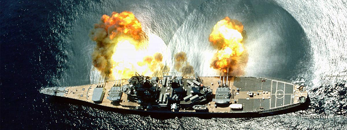 overview of the Battleship Iowa in the water firing canons in Los Angeles, California, USA