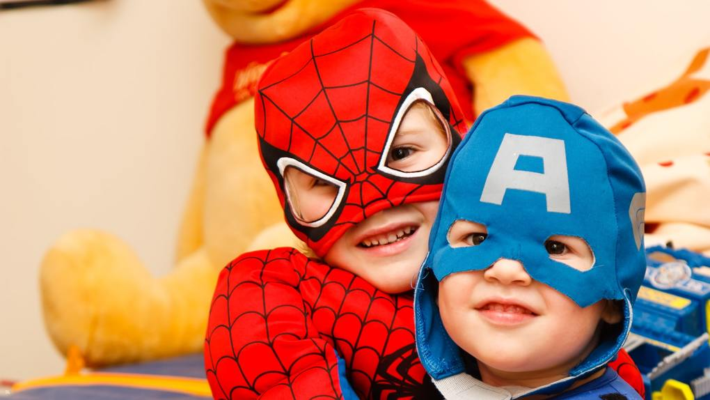 close up of two boys in superhero costumes for Halloween